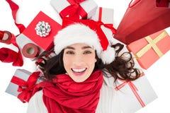 Festive brunette lying near christmas presents Royalty Free Stock Photo