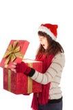 Festive brunette opening a gift Stock Image