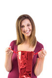 Festive brunette opening a gift bag Royalty Free Stock Photo