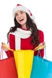 Festive brunette opening shopping bag Stock Photography