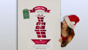 Festive brunette presenting a christmas card stock video footage