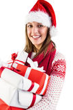 Festive brunette with santa hat holding many gifts Royalty Free Stock Photos