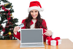 Festive brunette shopping online with laptop and pointing screen Stock Photos
