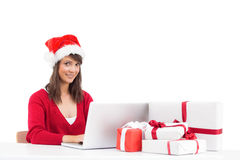 Festive brunette shopping online with laptop Stock Photos