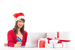 Festive brunette shopping online with laptop Royalty Free Stock Images