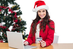 Festive brunette shopping online with laptop Stock Photography
