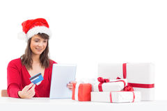 Festive brunette shopping online with tablet pc Royalty Free Stock Photo