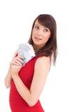 Festive brunette showing fan of dollars Royalty Free Stock Image