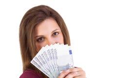 Festive brunette showing fan of euros Royalty Free Stock Image