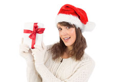 Festive brunette showing a gift Stock Image
