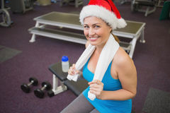 Festive brunette smiling at camera in fitness studio Stock Images