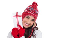 Festive brunette in winter clothes pointing gift Stock Photos