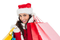 Festive brunette in winter wear holding shopping bags Royalty Free Stock Photo