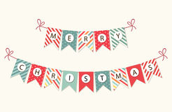 Festive bunting flags with letters Merry Christmas in traditional colors. For your decoration Stock Photos