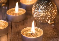 Golden Advent and Christmas decoration, candles with sparkling baubles stock photos