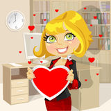 Festive business lady in office hold Valentine Stock Image