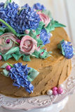 Festive cake with flowers of cream closeup. Stock Images
