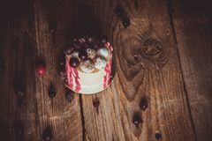 Festive cake with the fruits of cherry on a rustic wooden table on a dark background. close up copy space. vintage pattern on. Dessert tartlet. birthday holiday royalty free stock photos
