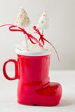 Festive cake pops in Santa boot cup Royalty Free Stock Photo