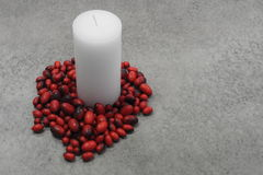 Festive candle with dried beans Royalty Free Stock Image