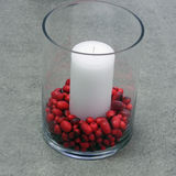 Festive candle with dried beans Stock Photos