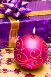 Festive candle and gift box Stock Photo