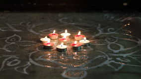 Festive candle lights. Decorated with an art kolam Stock Images