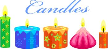 Festive Candles. Colorful festive candle wax with green ornaments Stock Image