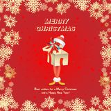Festive card for Christmas and new year. A cartoon character in the form of a gift and Santa Claus on a red background with snowfl. Akes Stock Image