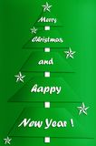 Festive card design with modern christmas tree. Festive card design of modern paper christmas tree with greetings in green-white colors Stock Images