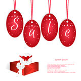 Festive card with red tags and the word sale, two boxes with bows. Suitable for web design and print. Royalty Free Stock Photo