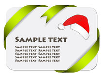 Festive card with ribbon and christmas hat Royalty Free Stock Photography