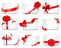 Festive cards with red gift ribbons Stock Photos