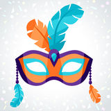 Festive carnival mask on background of confetti Royalty Free Stock Image