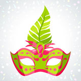 Festive carnival mask on background of confetti.  Royalty Free Stock Photography