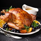 Festive celebration roasted turkey for Thanksgiving royalty free stock photography