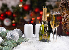 Festive Champagne and Candles on Snowy Surface Royalty Free Stock Images