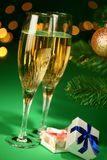 Festive champagne glasses with gifts Stock Photos