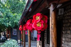 Festive Chinese decoration. Chinese red lanterns hang on the facade of a building on the street. royalty free stock images