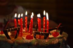 Festive chocolate cake with candles royalty free stock image