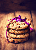 Festive chocolate chip cookies wrapped with  ribbon   on wooden Stock Image