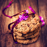 Festive chocolate chip cookies wrapped with  ribbon   on wooden Royalty Free Stock Photography