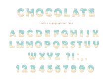 Festive chocolate font. Cute letters and numbers can be used for birthday card. Blue cream melted on white chocolate decorative alphabet. Cute ABC letters can be Royalty Free Stock Photography