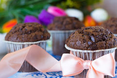 Festive chocolate muffins. Chocolate muffins on the board written under gzhel Stock Photos