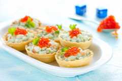 Festive Christmas appetizer tartlets stuffed with salmon salad a Stock Images