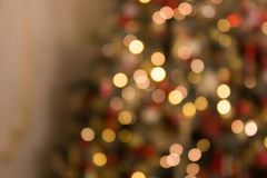 Blurred colored circles on a light holiday background. A festive Christmas background with a bokeh of Christmas tree lights. Blurred colored circles on a light royalty free stock photos