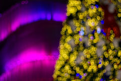 Festive Christmas background of defocused decorated xmas tree bokeh composition. Christmas festival happy party symbol Stock Photos