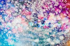 Festive Christmas background. Elegant abstract background with bokeh defocused lights and stars. Abstract light celebration background with defocused golden Stock Images