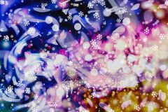 Festive Christmas background. Elegant abstract background with bokeh defocused lights and stars. Abstract light celebration background with defocused golden Royalty Free Stock Photo
