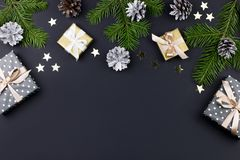 Festive Christmas background with fir branches, giftboxes, decorations, copy space, top view. Festive Christmas background with fir branches, giftboxes stock photo